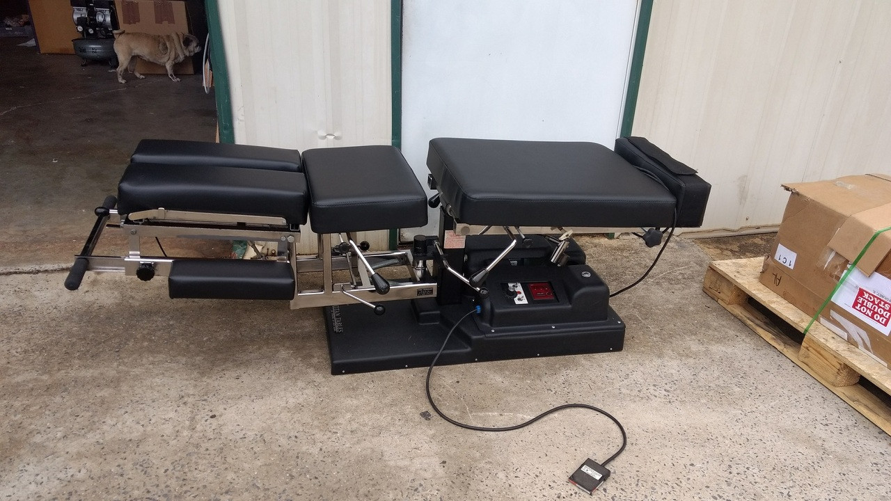Used Titan Elevation Auto Flexion Table With Pelvic Drop