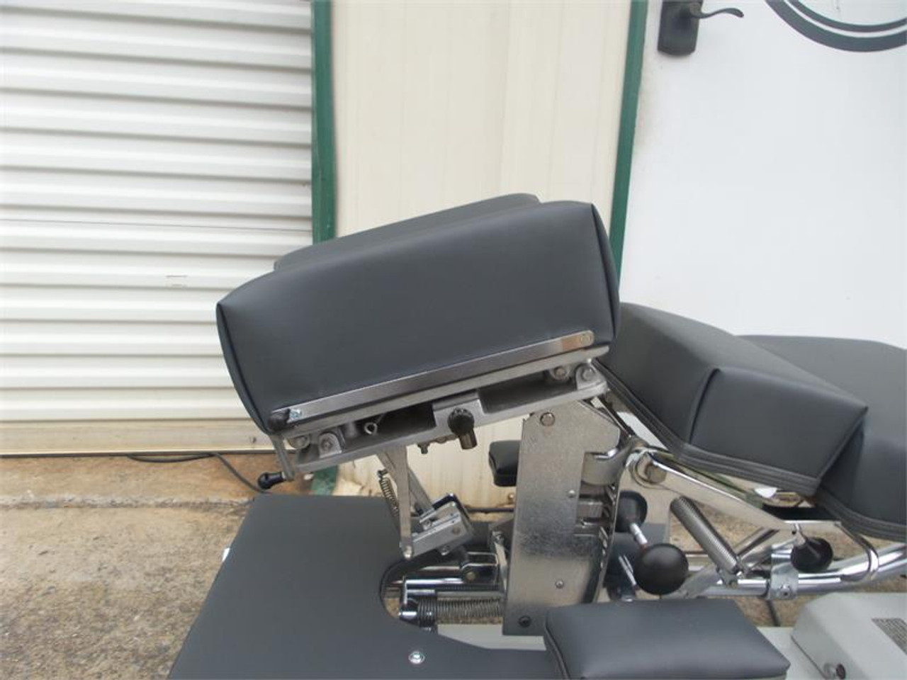 Used Zenith II 220F Hylo Table shown with Negative and Positive Tilt head ,Forward Motion Cervical Drop.