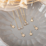 14k Gold Star with Tiny Diamond Pendant