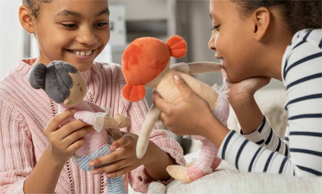 Girls playing with soft dolls