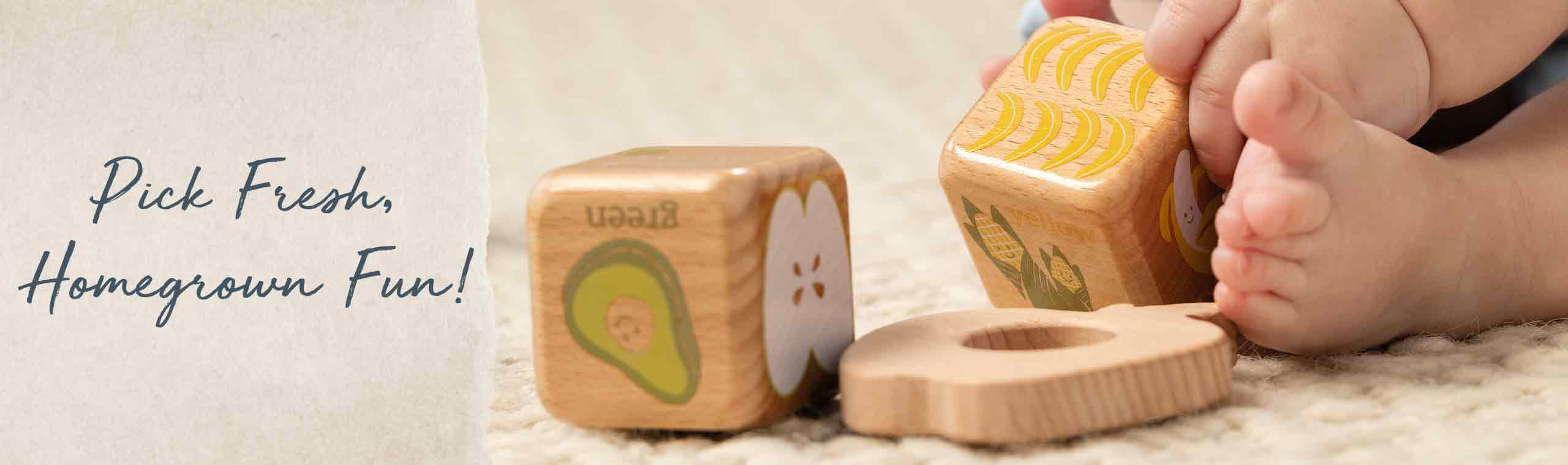 Pick Fresh, Homegrown Fun! a baby playing with wooden block with farm themed prints on them