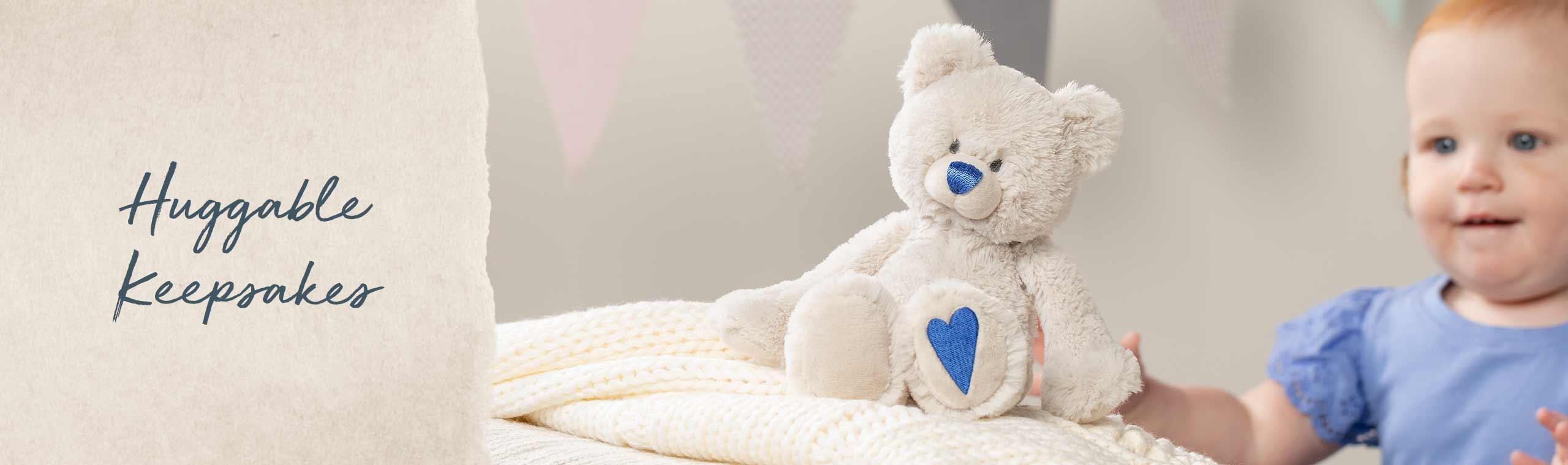 Huggable Keepsakes! soft bears with a blue heart on thir feet