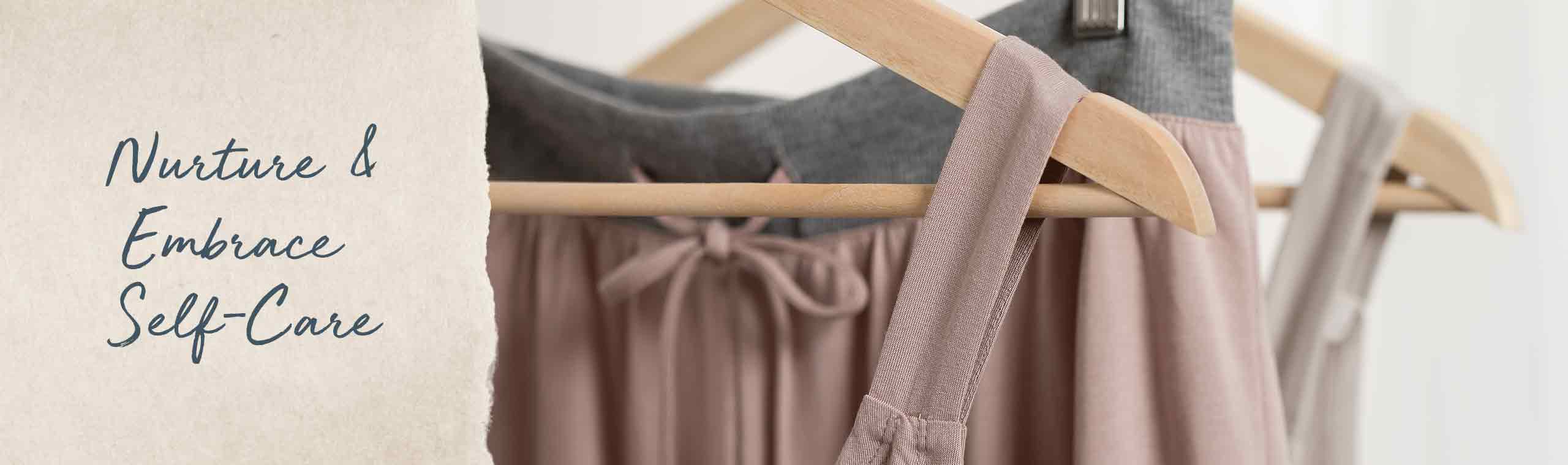 Nurture and Embrace self-care! comfortable apparel hanging on hangers