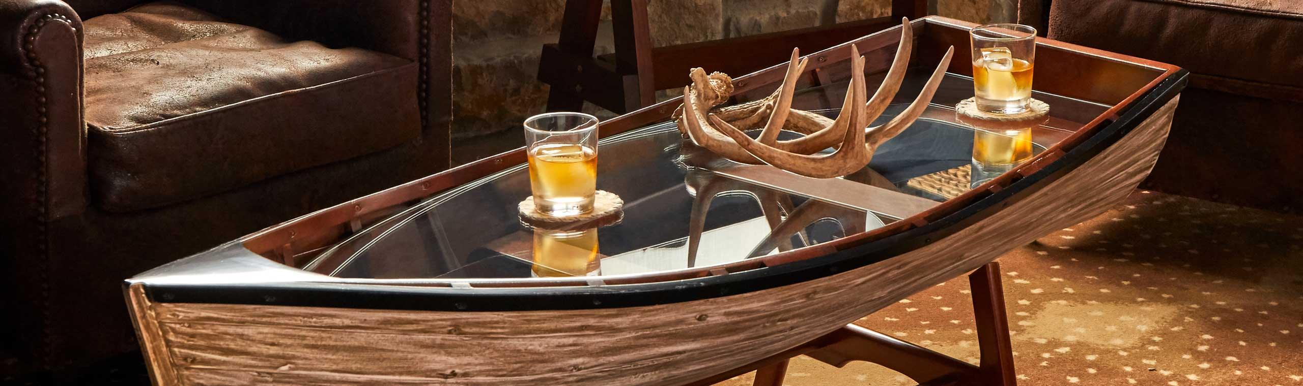 Wooden boat with glass on the inside to make it a perfect coffee table