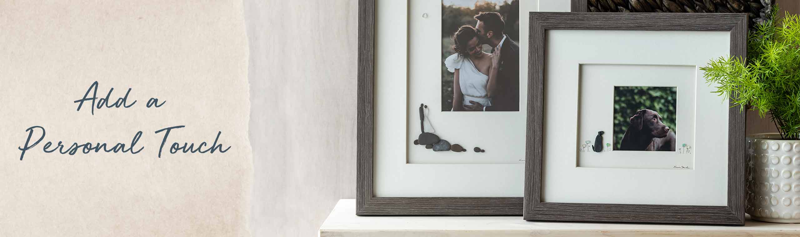 Add a Personal Touch. frames on a table with people made of stones and a couple in the photo