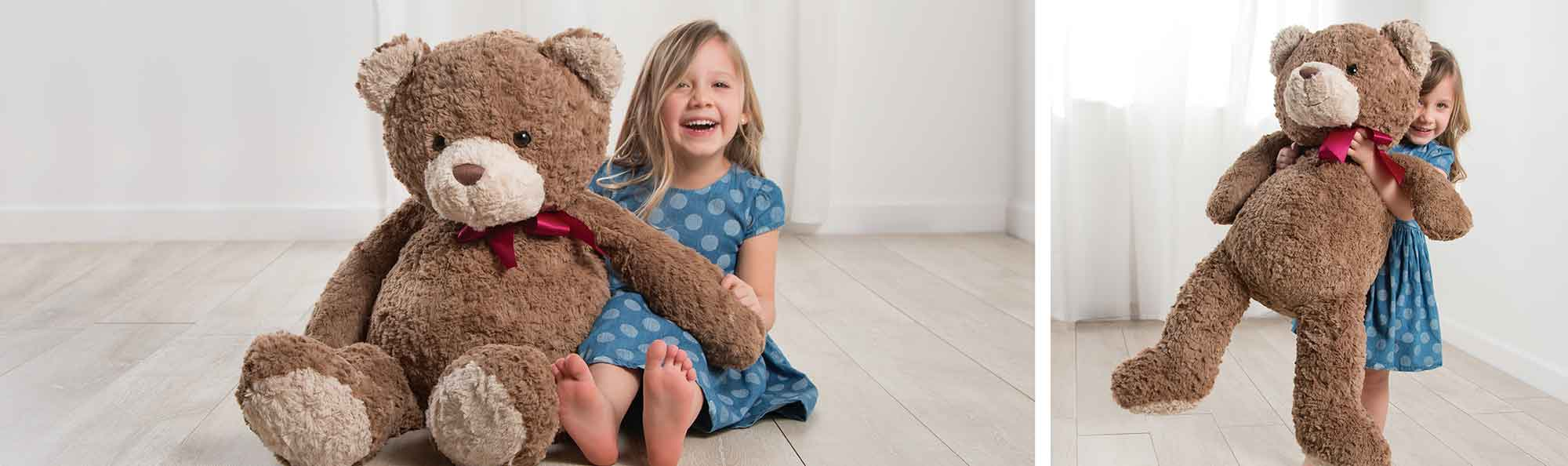 a little girl setting next to her new bear and another photo of her showing off that bear by holding it up