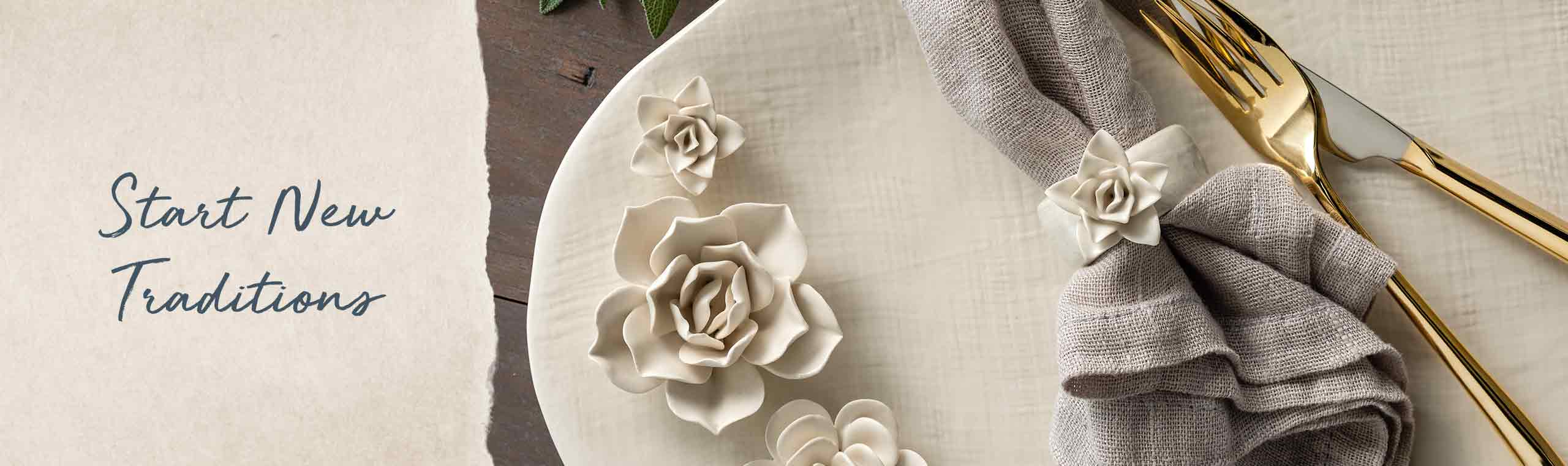 a ceramic plate with a napkin and silverware on top