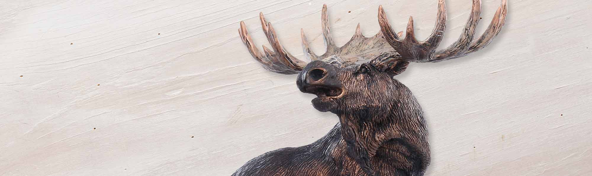 Marc Pierce's signature moose products shown on a white washed wood