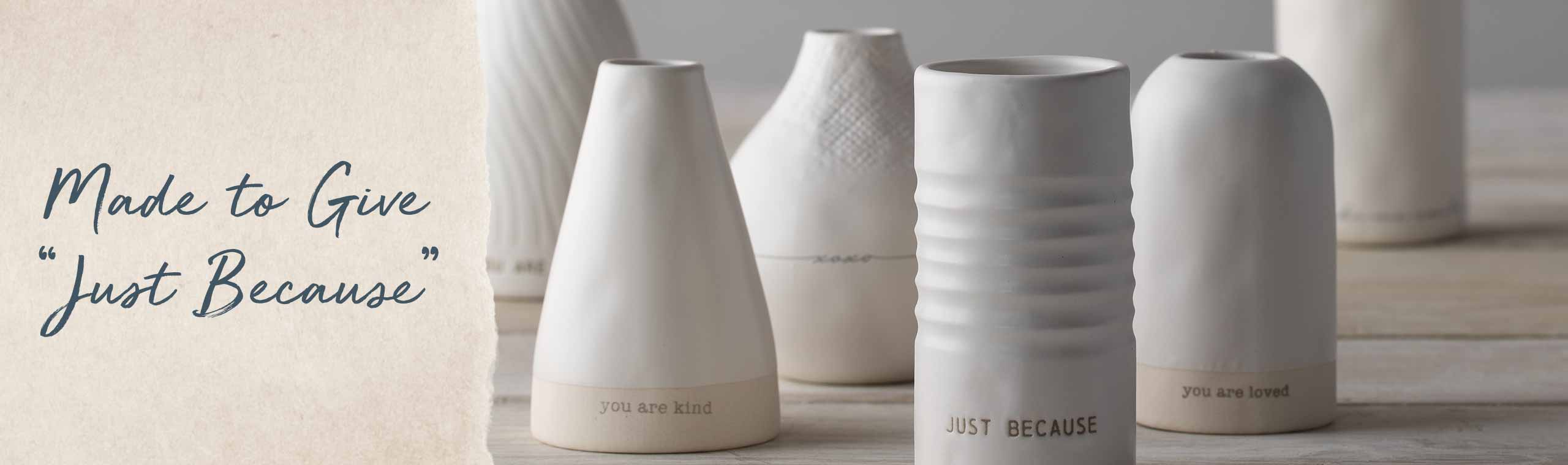 Made to give just because, ceramic vases with compliments on them