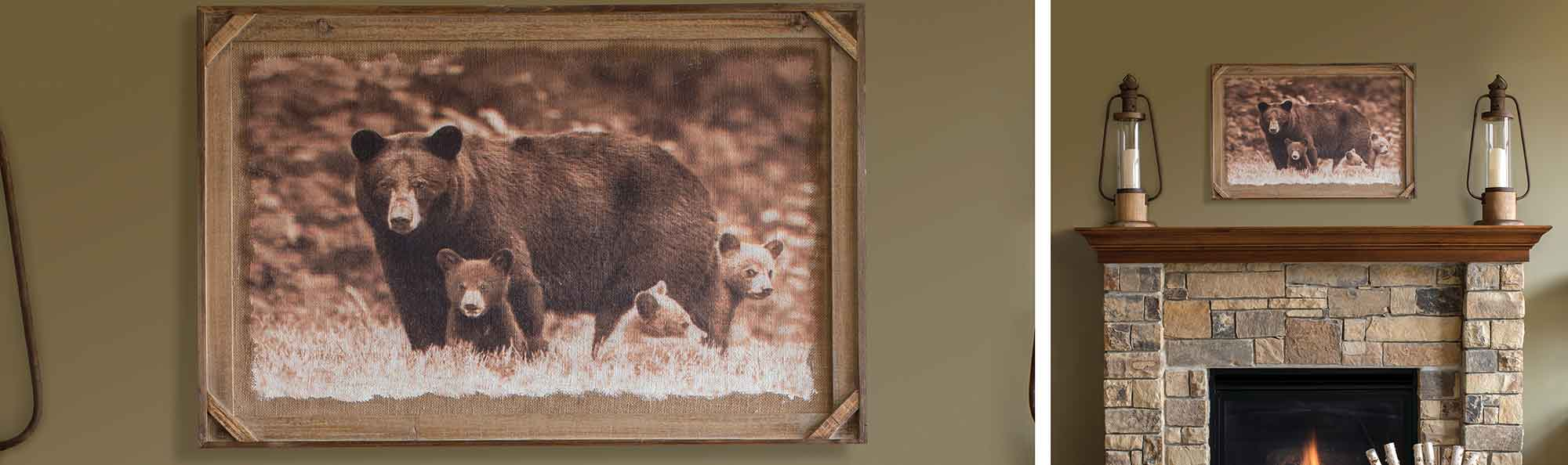 Photo in a fame of two bears above a fireplace