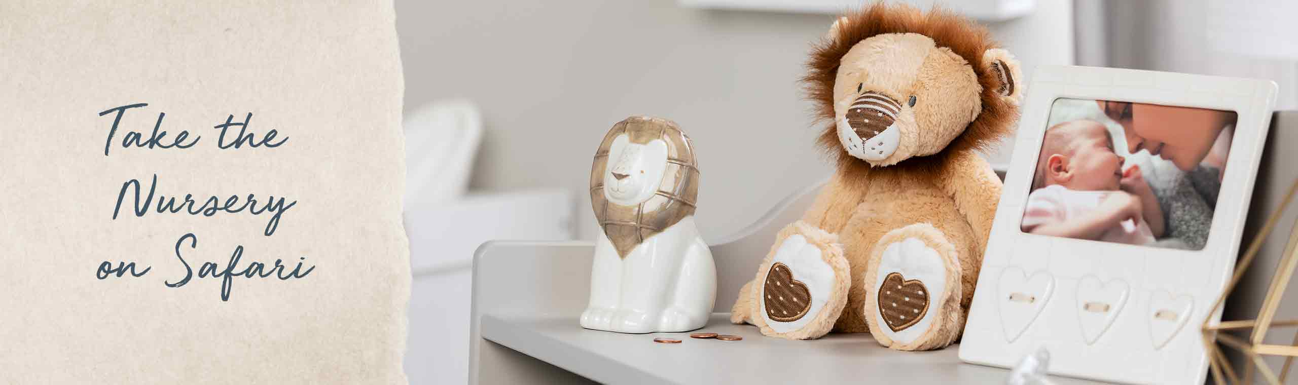 Take the Nursery on a Safari! a Photo of a stuffed lion next to a baby frame