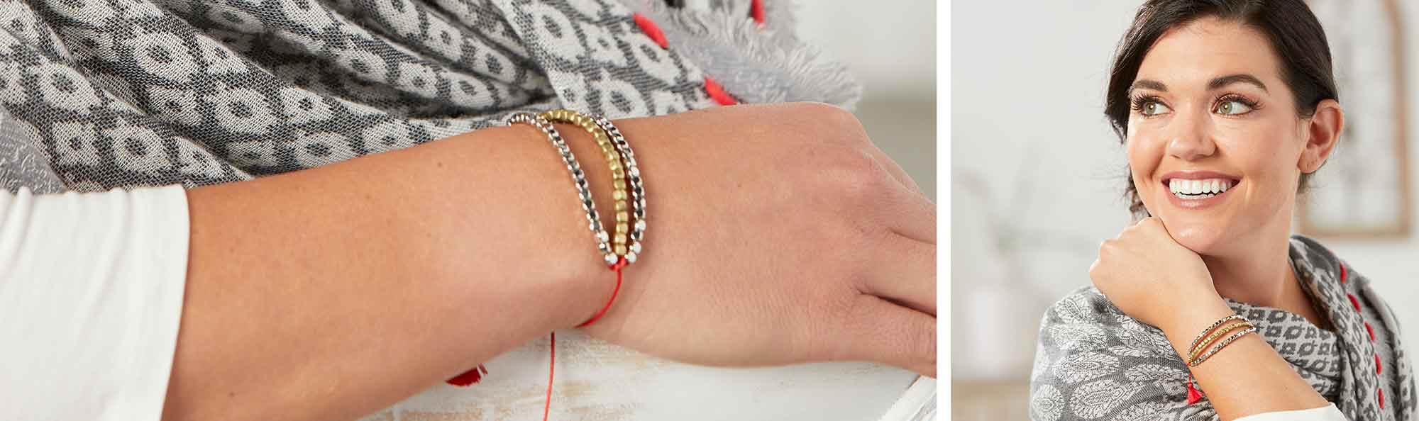 a red thread bracelet and a woman smiling with her arm on her neck and bracelet on her wrist