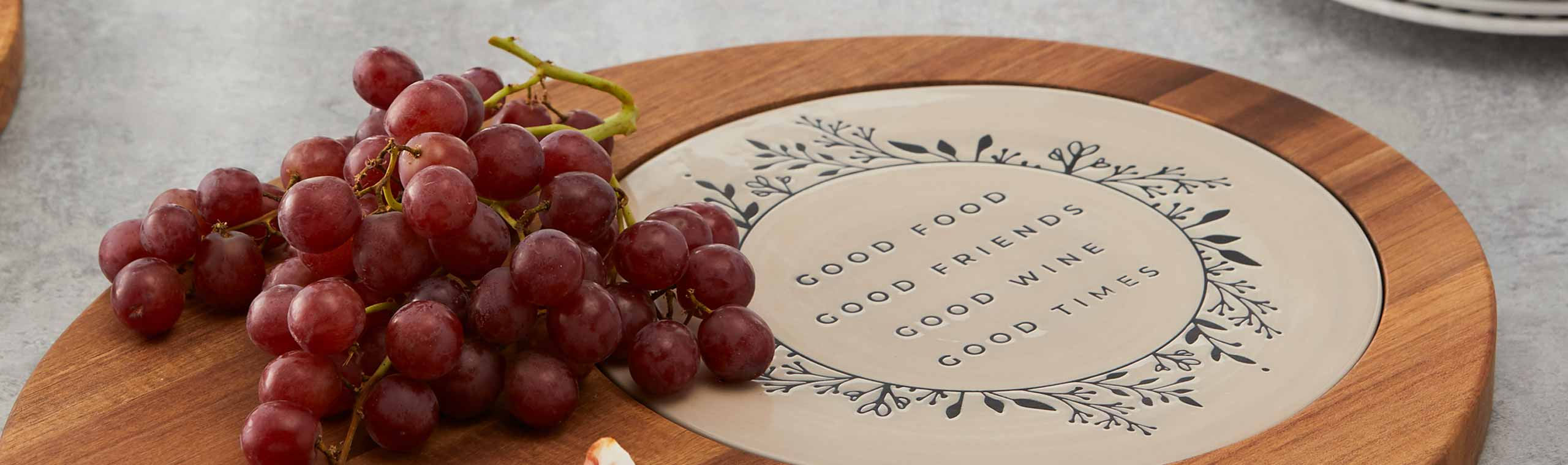 wooden plater with a ceramic disk and an inspriing quote