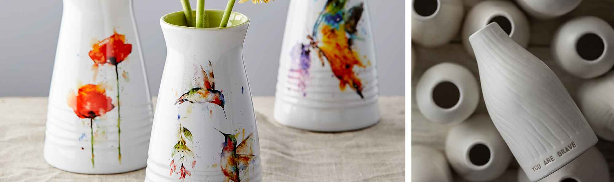 Water colored vases of flowers with flowers inside