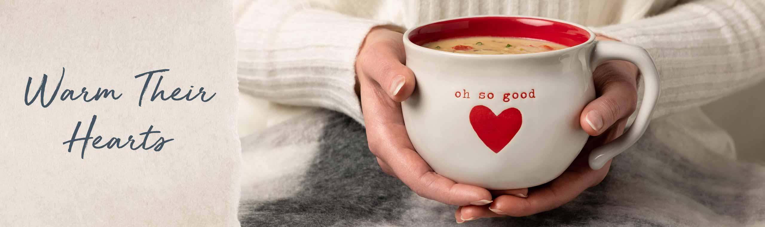Warm their hearts! a black mug with grandpa writen