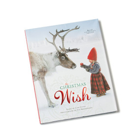Christmas Wish book cover- scene of reindeer with little girl holding apple up to it