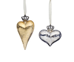 A set of two silver and gold heart shaped ornaments. Each topped with a silver crown.