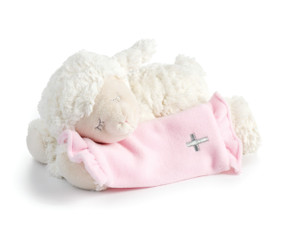 White stuffed lamb laying down holding light pink blanket with silver cross