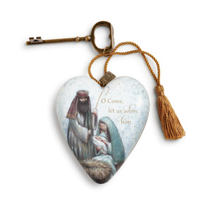 ceramic heart with manger scene and O Come Let us Adore Him printed on it with brass key and hanging string