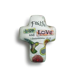 Faith hope and love' printed on white cross figurine with hummingbird and flower print