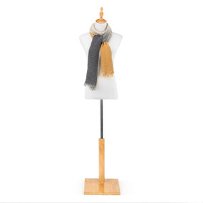 """A yellow and gray """"Our Bond"""" scarf, draped as a shawl on a white and black metal mannequin."""