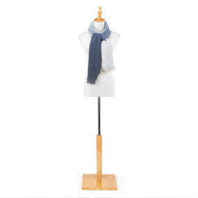"""An ivory and blue """"Our Bond"""" scarf, draped as a shawl on a white and black metal mannequin."""