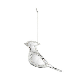 A filled crystal glass ornament in the shape of a cardinal, and with a thin silver string.