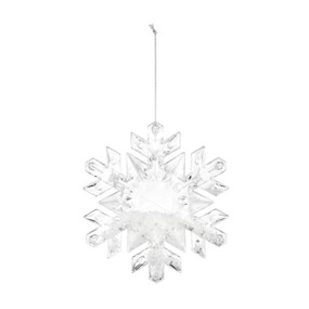 A filled crystal glass snowflake shaped ornament, with a thin silver string.