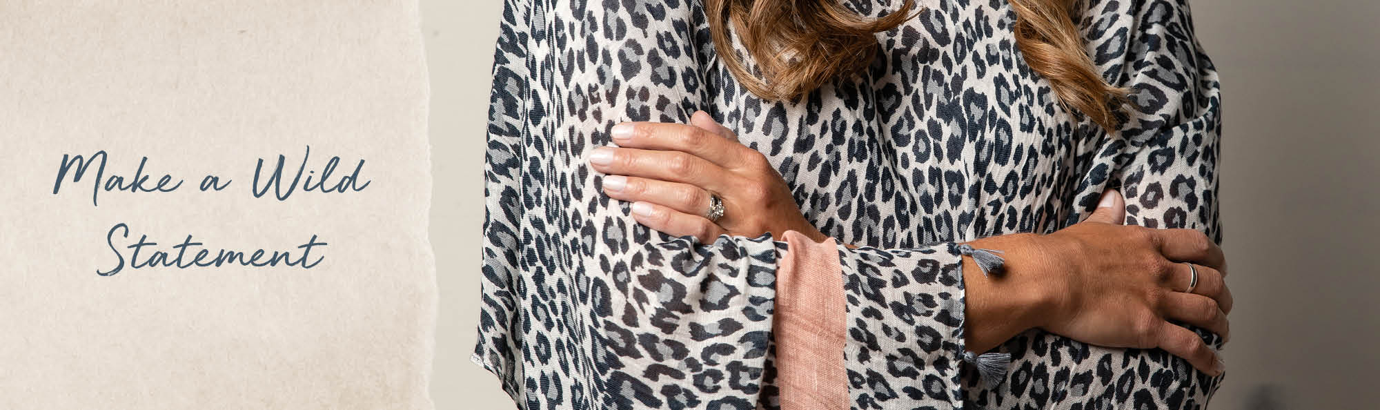 Make a wild statement. Woman wearing an animal print poncho.