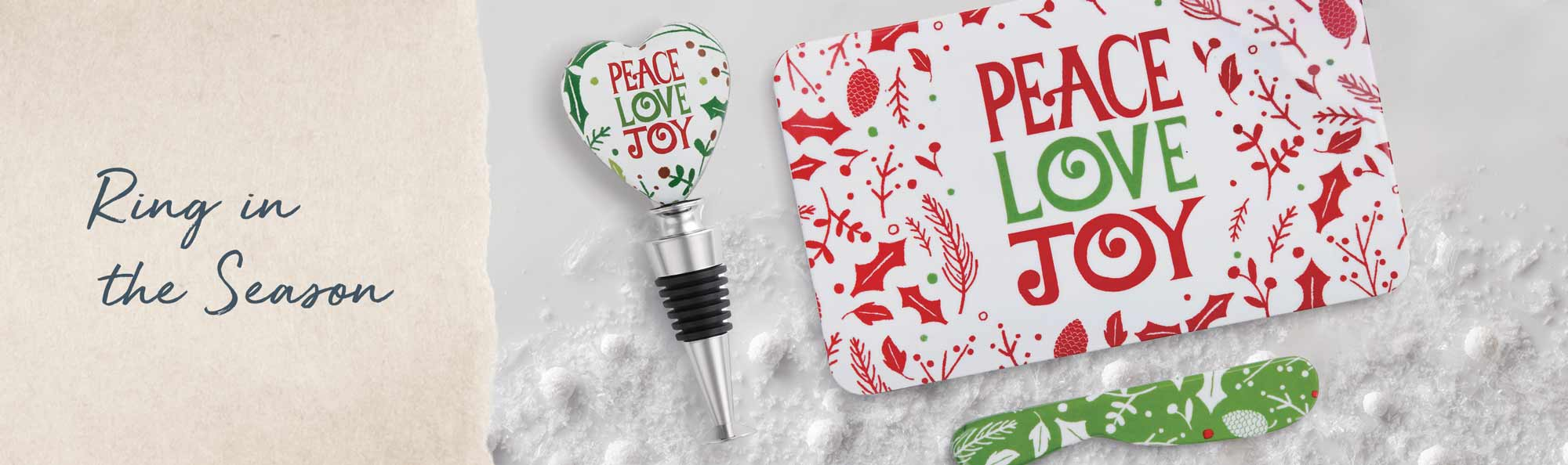 Ring in the Season. Bottle stopper and serving tray decorated in red and green words of Peace Love Joy.