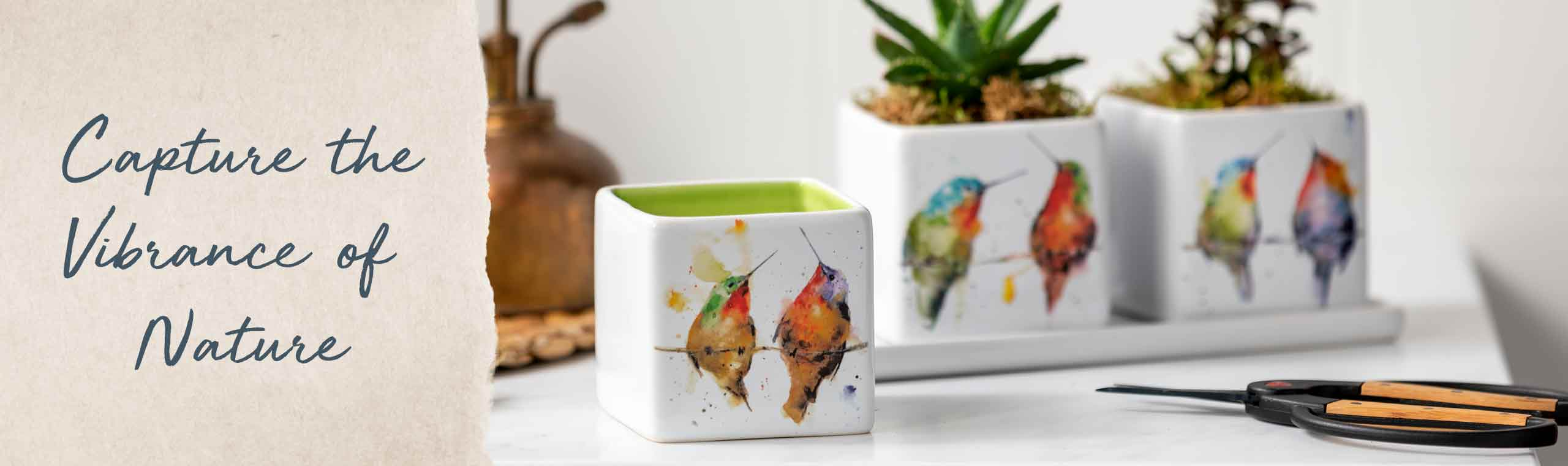 Capture the Vibrance of Nature. Set of three planter pots decorated in colorful watercolor birds.