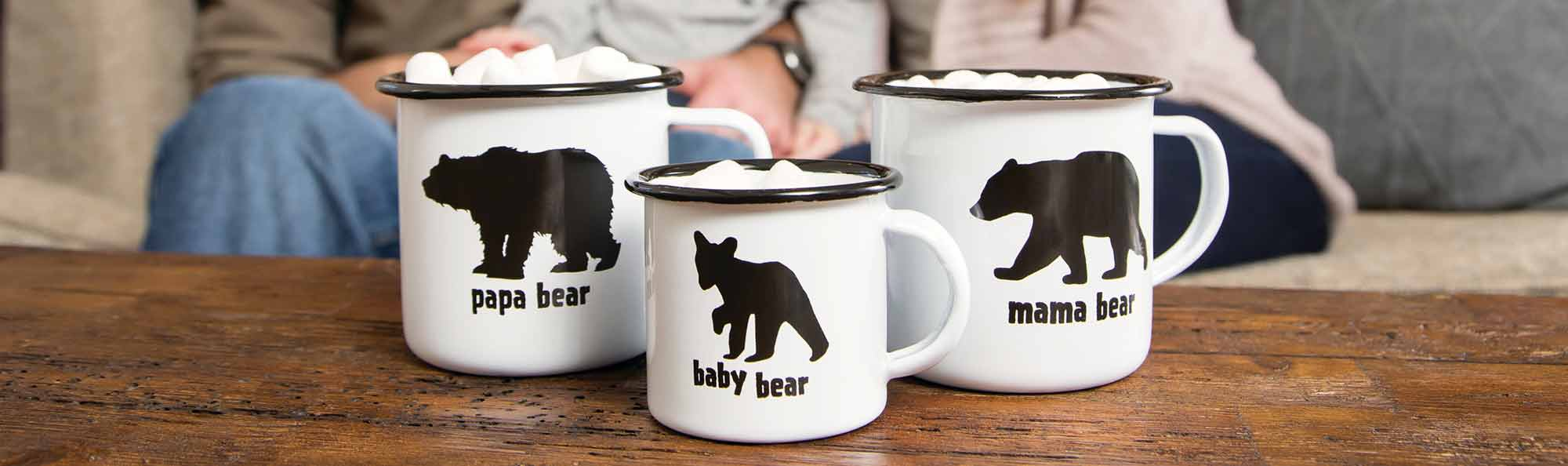 Row of mugs in front of a family that say Papa Bear, Mama Bear, Baby Bear
