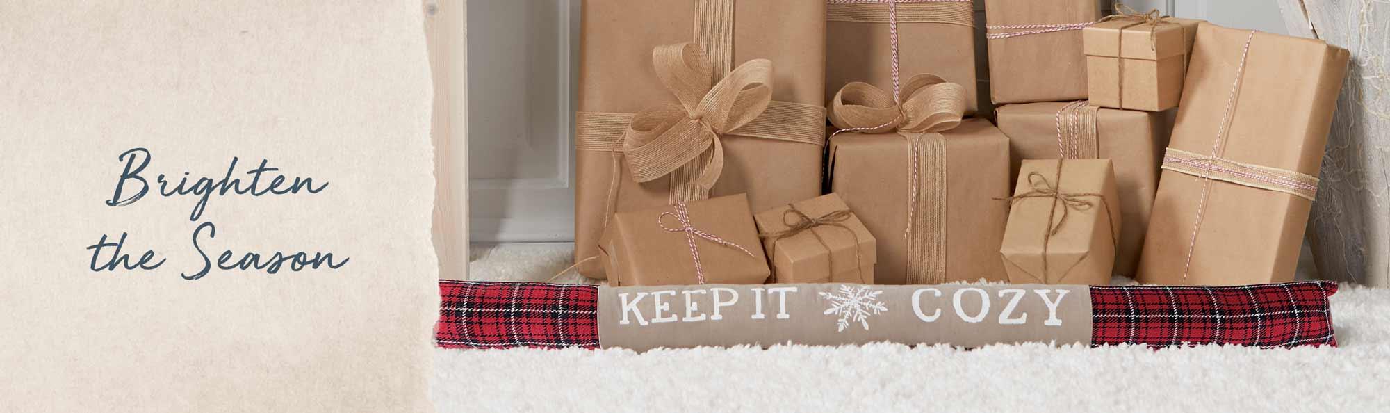 Brighten the season. Door stop with the words Keep it Cozy.