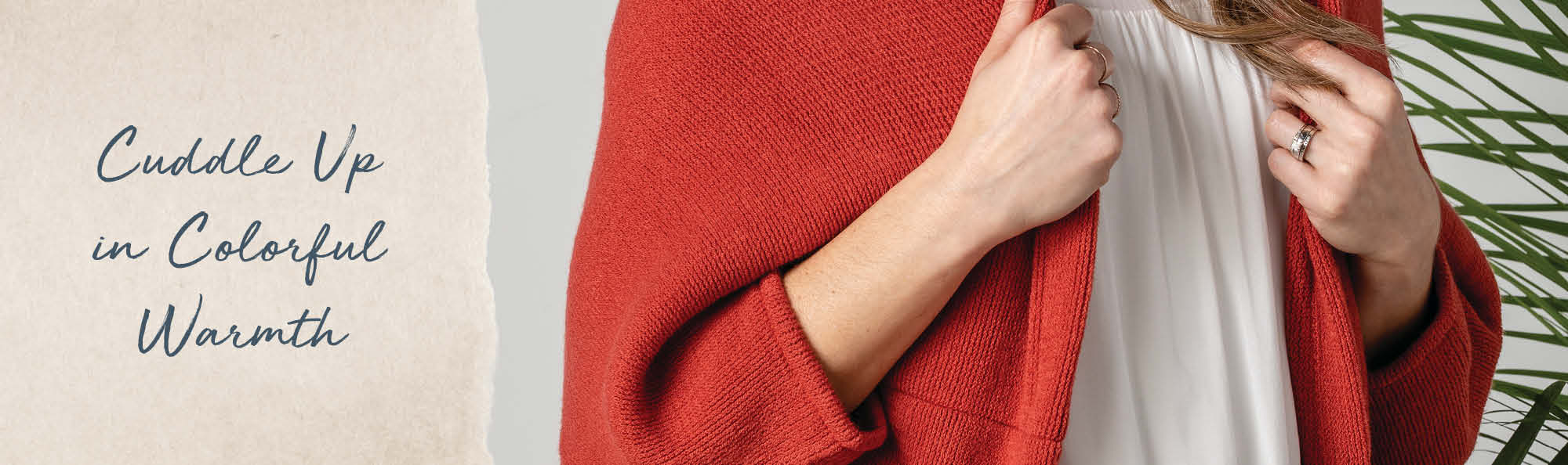 Cuddle up in colorful warmth. Woman in a soft red wrap.