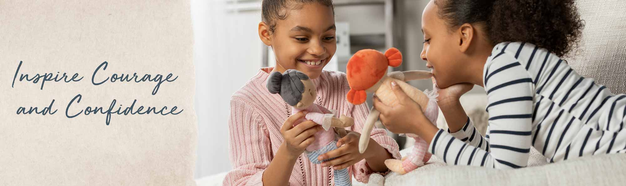 Inspire Courage and Confidence. Young girl playing with a soft doll that looks like her.