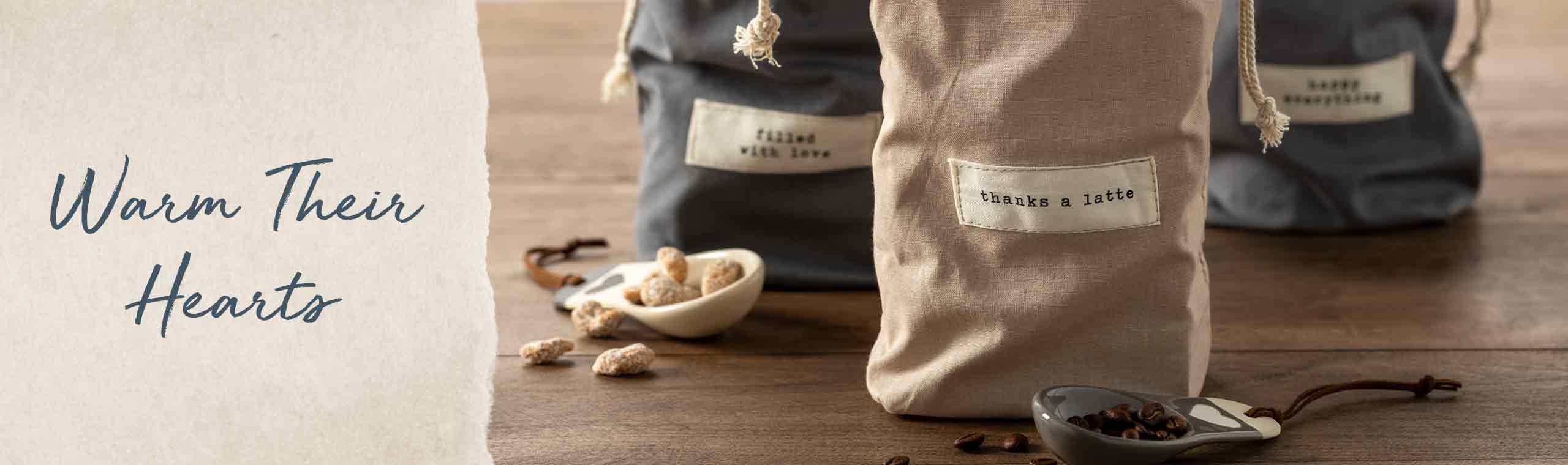 Warm Their Hearts. Three linen bags with the words Filled with Love, Thanks a Latte
