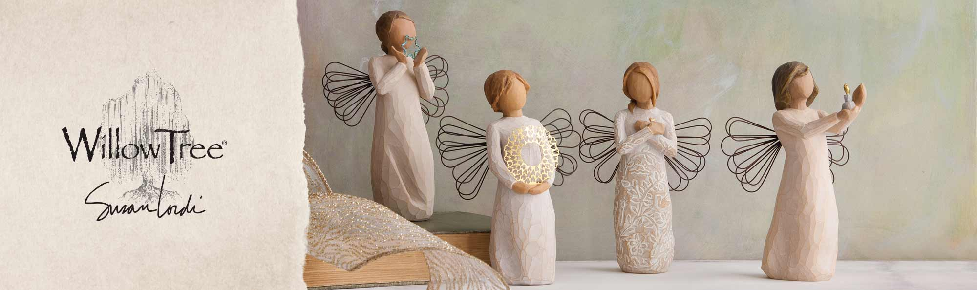 Willow Tree by Susan Lordi. Four hand carved angel figurines.