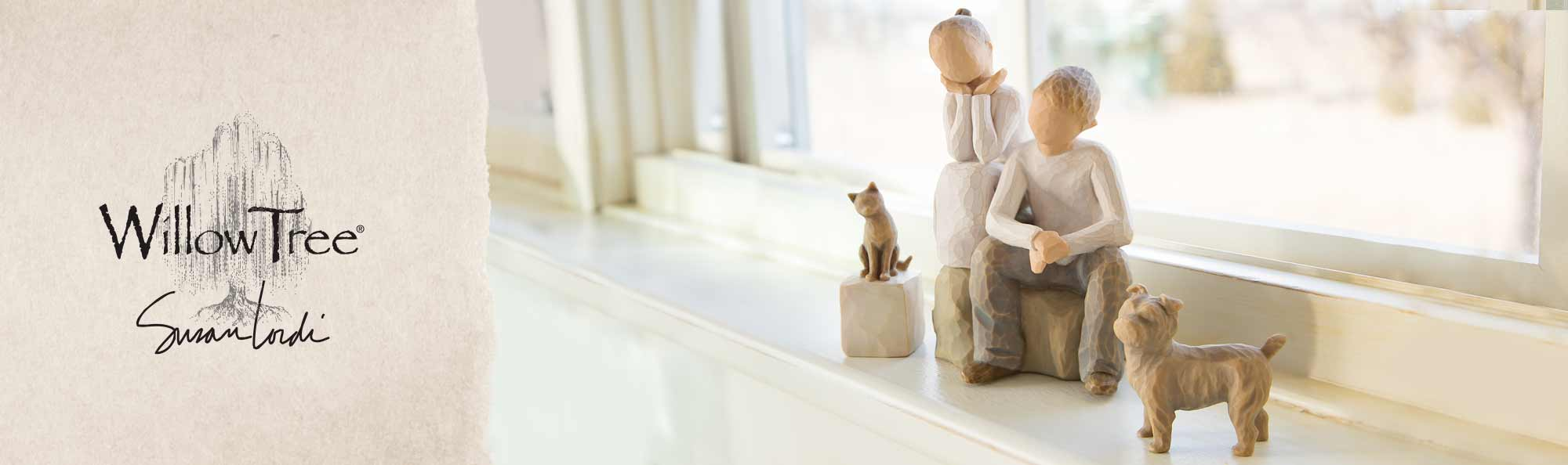 Willow Tree by Susan Lordi. Hand carved figurines of a cat and dog with two children.