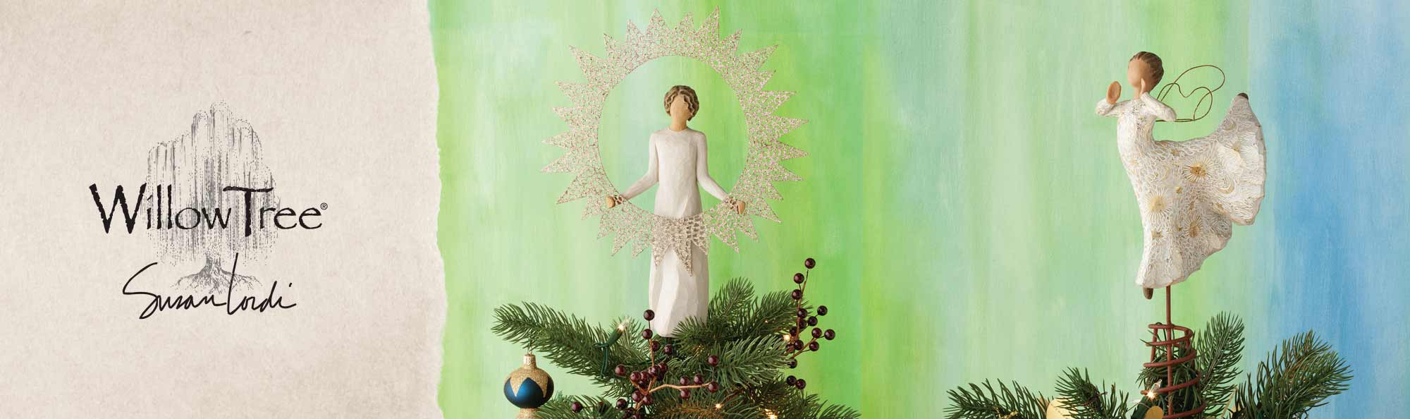 Willow Tree by Susan Lordi. Hand-carved figurine of girl on top of a tree holding a gold star wreath. Hand-carved angel on top of a tree.