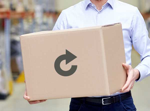 Warehouse worker holding a brown shipping box with an arrow in the shape of a circle