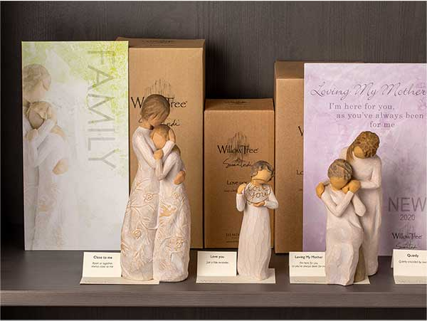 Willow Tree hand carved figurines on display on a store shelf