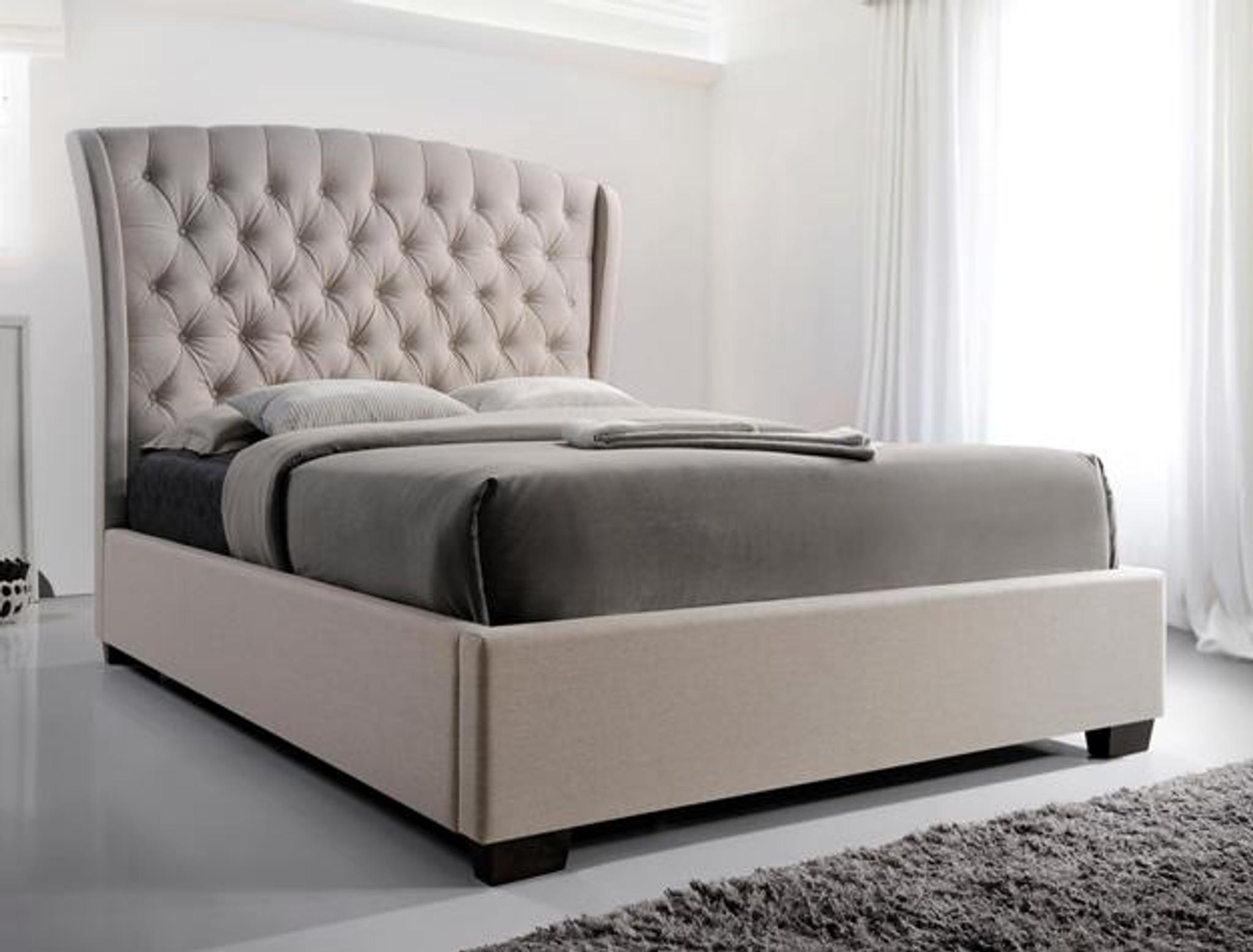 grey tufted platform bed