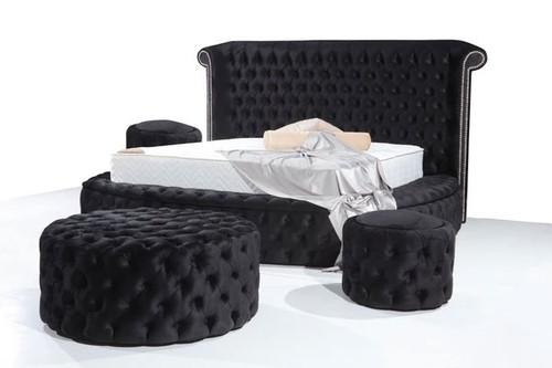 Wyatt Velvet Black King Storage Platform Bed with two storage ottomans.
