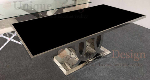 Stainless steel table with black glass