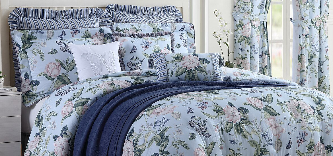 Picture of Blue Garden Images bedding collection in a bedroom.