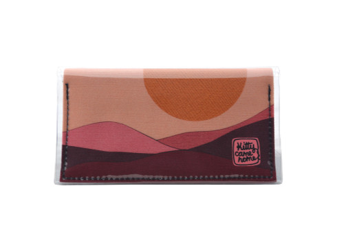 This is an image of the front of a Kitty Came Home bifold mini purse clutch in the 'Moonage daydream' design by Satin and Tat. A golden moon suspended above a burgundy landscape. This is the mini size.