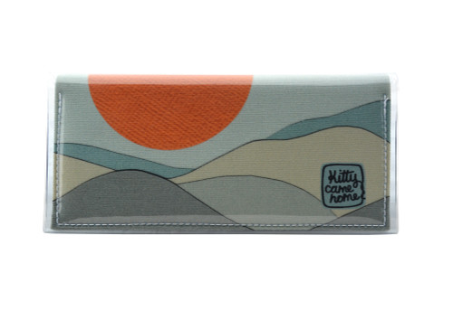 This is an image of the front of a Kitty Came Home bifold purse clutch in 'The night grows pale' design by Satin and Tat. An orange moon floats above a mist coloured landscape. This is the standard size.