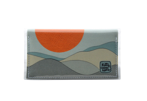This is an image of the front of a Kitty Came Home bifold purse mini in 'The night grows pale' design by Satin and Tat. An orange moon floats above a pale landscape. This is the mini size.