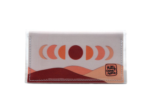 This is an image of the front of a Kitty Came Home bifold mini purse clutch in 'The same moon shines' design by Satin and Tat. The moon appears in all its phases in a white sky above a landscape lit by the moon's colours: burgundy, oranges, and apricot. This is the mini size.