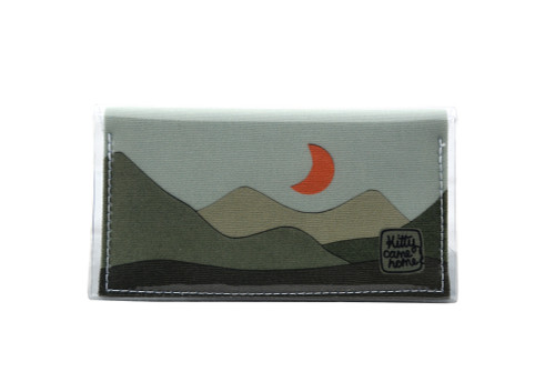 This is an image of the Front of a Kitty Came Home bifold mini purse clutch of the 'Moondance' design by Satin and Tat. An orange crescent moon floats above a landscape of dark green hills. This is the mini size